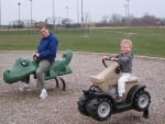 I rode a tractor at the park while Daddy road an Alligator!